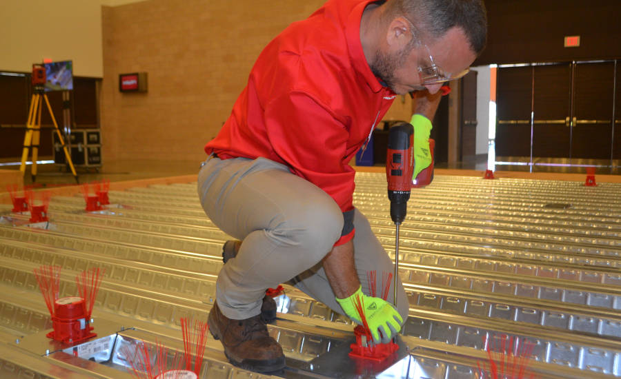 A Hilti rep demonstrates the company's new Cast-in Device for Metal Deck