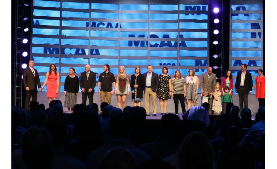 Outgoing MCAA president Tom Stone is joined onstage by his fiancée, Sharon Glynn, as well as the rest of his family during MCAA 2017 in San Diego