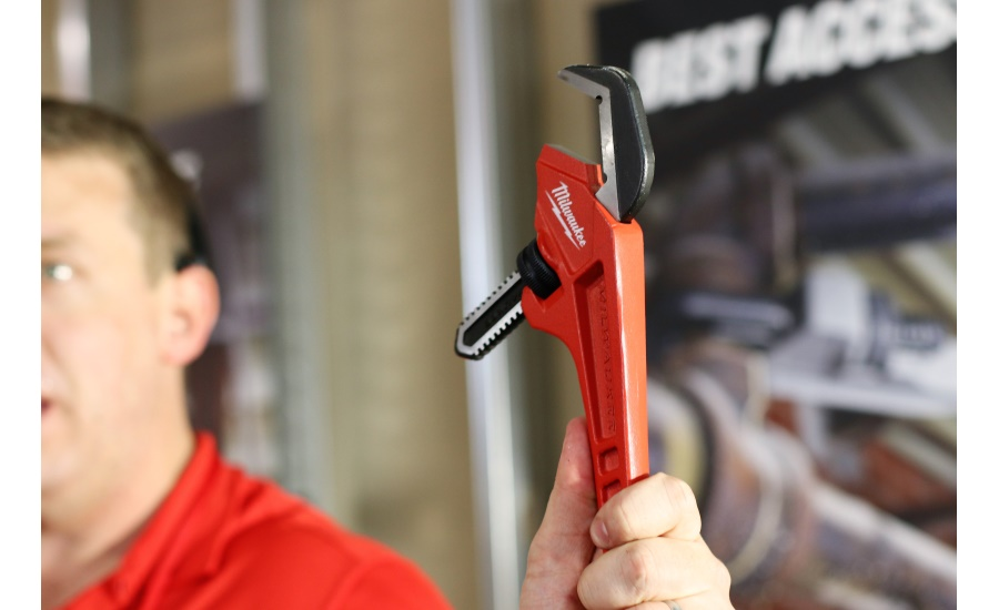 Senior Product Manager Brian Doyle shows off the newest adjustable pipe wrenches