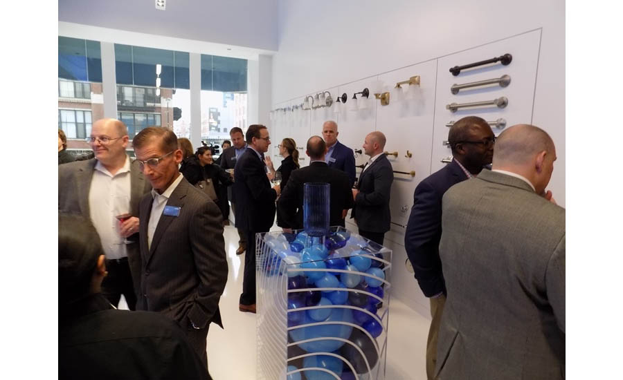 The wall of Moen bathroom accessories was a popular spot to mingle during the grand opening event