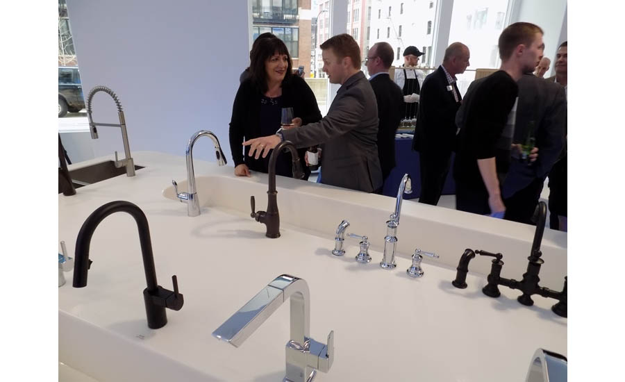 Visitors to check out one of the multiple rows of working Moen faucets