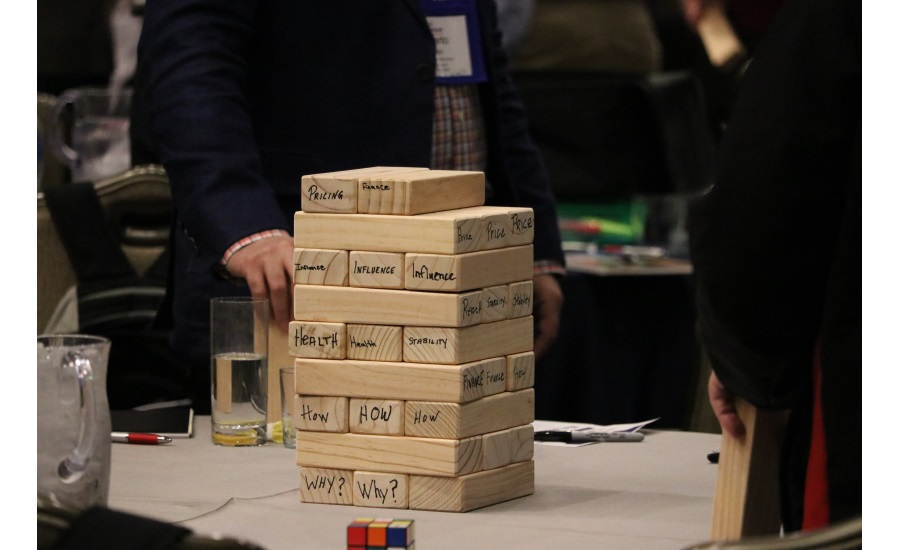 "Attendees use wooden blocks to ""build"" their businesses from the ground up During Nexstar Network's Leadership Spotlight 2017 closing session"