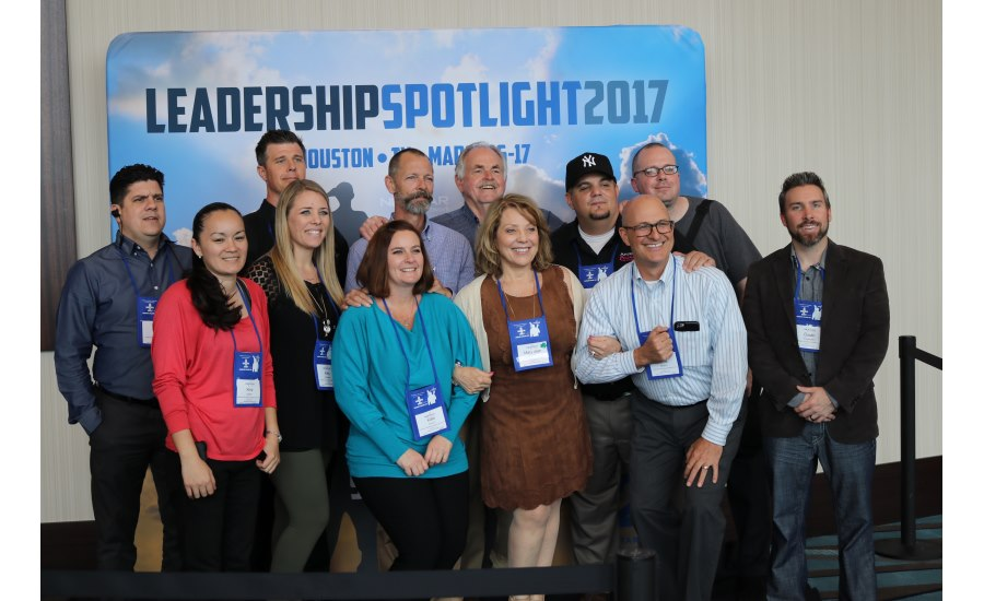 Mary Jean Anderson (front row, center) poses with her employees following the closing session of Nexstar Network's Leadership Spotlight 2017