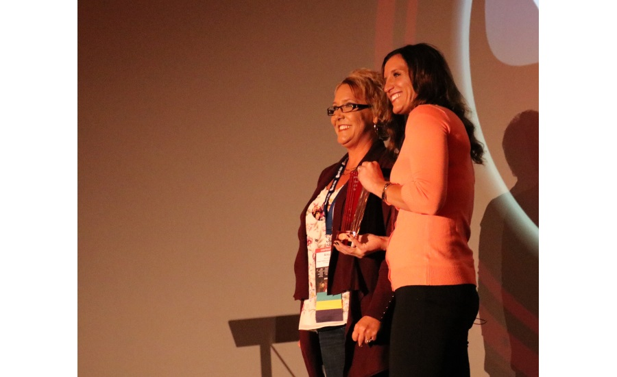 Angie Snow presents the 2017 Woman of the Year award to Amy Davis (left), vice president of Budget Plumbing, Heating and Cooling in St. Peters, Mo., at the 2017 Service World Expo in Las Vegas