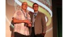 Tom Piscitelli (left) receives the Tom McCart Award from BNP Media Group Publisher Mike Murphy Sept. 8 at the 2017 Service World Expo in Las Vegas