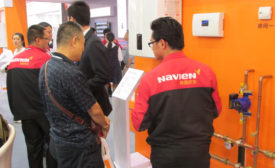 A Navien employee discusses the company�¢??s commercial condensing boiler