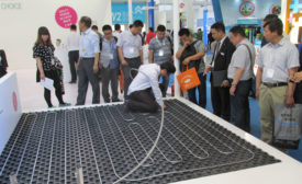 Visitors to REHAU�¢??s booth Wednesday at the 2015 ISH China trade show