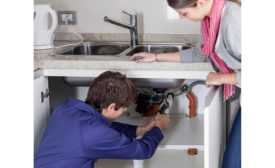 Plumbing contractor with customer