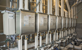 An engineered rack system connects as many as six tankless water-heating units
