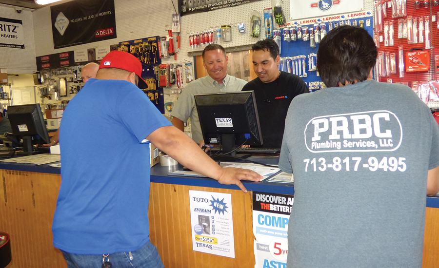 Glenn Fuller and Luis Mares assist plumbers