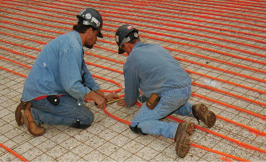 Installers in Missouri lay out and attach miles of Watts Radiant tubing