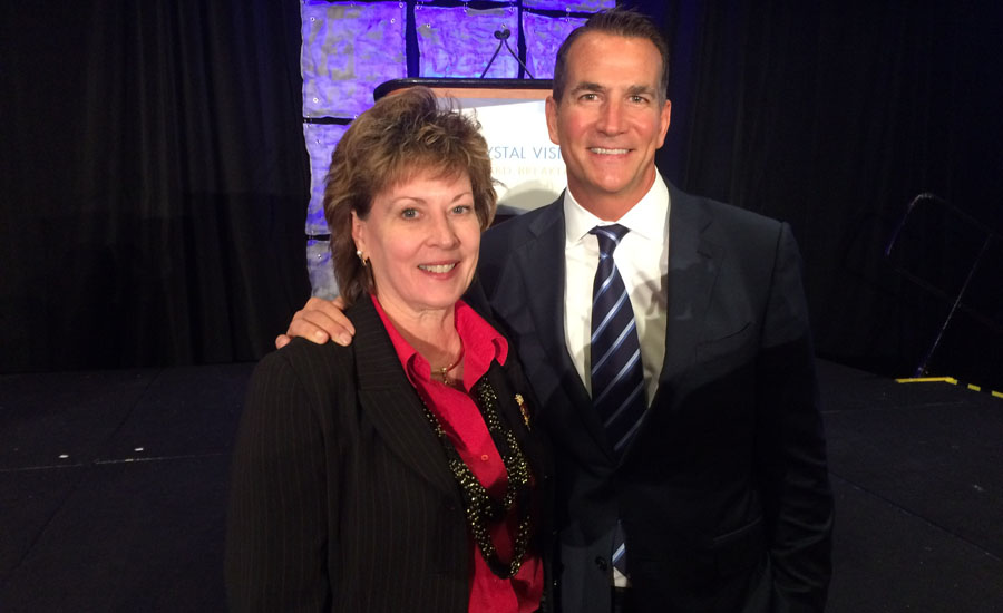 Plumbing Manufacturers International CEO Barbara Higgens stands with Kohler Co. President and CEO David Kohler