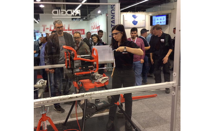 Trade visitors watch a product demo at the RIDGID Tool