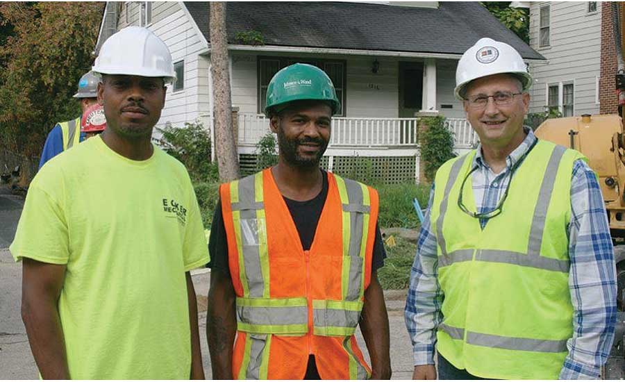 Flint residents and plumbing apprentices Anthony Jones (left) and Perry Alexander (center) pause for a photo with instructor Howard Hipes (right)