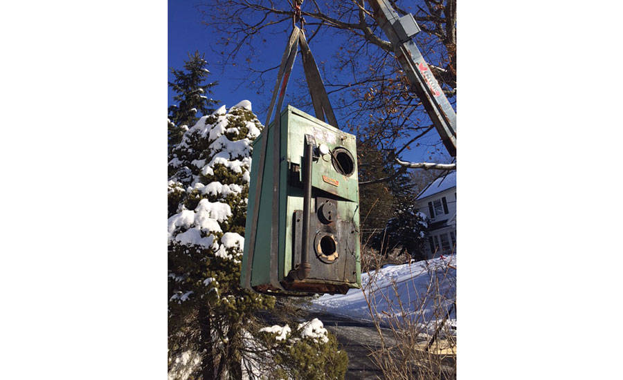 The old boiler being removed by James Outhouse