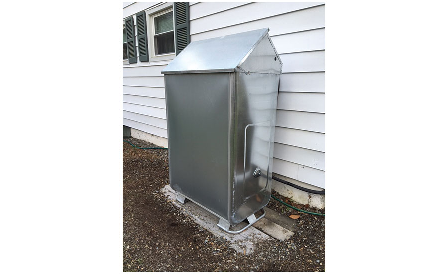 A rain shield was installed to protect the new outside tank