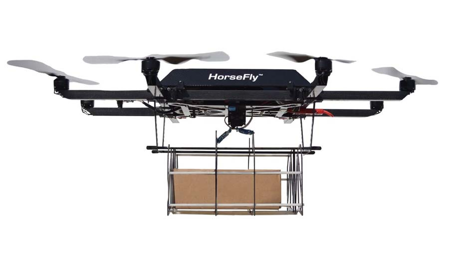 The carbon-fiber, high-efficiency octocopter drone launches from the roof of a delivery van