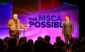 Actor and industry advocate John Ratzenberger (left) speaks to attendees of MSCA CONNECT Oct. 18 in Boca Raton, Florida, as MSCA outgoing Chairman Chris Carter looks on.