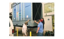 Students and instructors install a Marley NC cooling tower that serves as the centerpiece