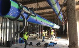 An overhead run of large-diameter Aquatherm pipe