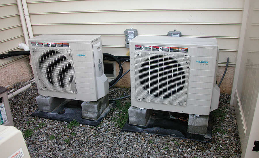 Two 2.5-ton air-to-water heat pumps