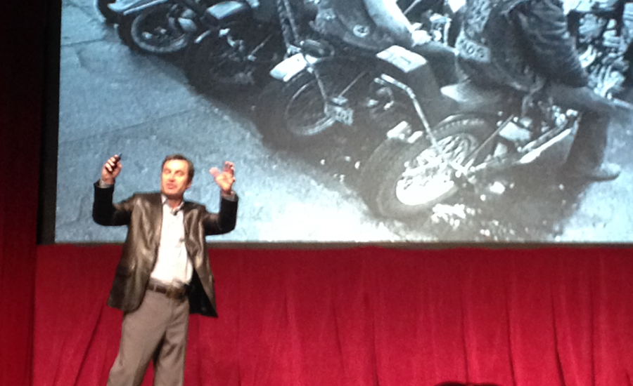 Former Harley-Davidson executive Ken Schmidt gives a rousing speech