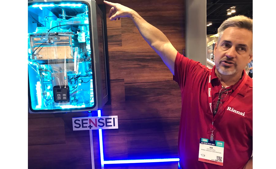 Rinnai's Joe Holliday demonstrates the company's new Sensei tankless water heater
